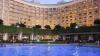 सरकार ने  होटल रूम में घटाई GST दर