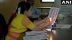 Maharashtra Election 2019: बिजली गुल होने पर मोमबत्ती जलाकर मतदान, बारिश में छाता लेकर आए मतदाता