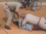 VIDEO: पूछताछ में ही पुलिस ने शुरू कर दी पटका-पटकी, राहगीरों ने बना लिया LIVE वीडियो