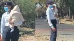 VIDEO: बच्चे को गोद में लिए ड्यूटी कर रही महिला पुलिसकर्मी की हुई तारीफ, विभाग ने शुरू की जांच