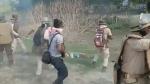 असम झड़प: पुलिस के सामने गोली से घायल प्रदर्शनकारी को लात से मारता रहा फोटोग्राफर, हुआ गिरफ्तार