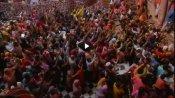 VIDEO: लाखों लोग होली खेलने कृष्णनगरी मथुरा पहुंचे, बांके बिहारी मंदिर में पैर रखने को जगह नहीं, देखें