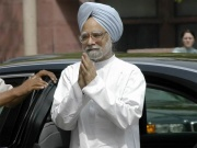 UPA-II releases report card; Sonia backs PM, lashes out at opposition.