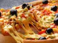 मित्तल परिवार के दो सदस्य भारत में बढ़ा रहे पिज्जा का व्यापार