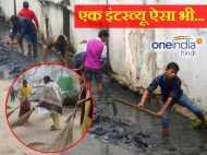 यूपी: नौकरी के लिए बीए पास युवाओं ने साफ किया नाला, झाड़ू भी लगाई