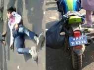 बाइक से टकराकर पलट गई लोगों से भरी बस, देखिए हादसे का यह VIDEO