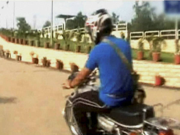 Mahendra Singh Dhoni on bike