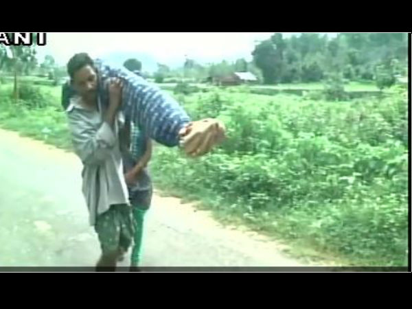tribal man carries wife's body for 10 km
