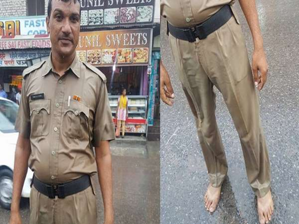 policeman doing duty without shoes in rain
