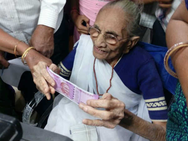 PM Narendra Modi's mother Heeraben reaches bank to exchange currency