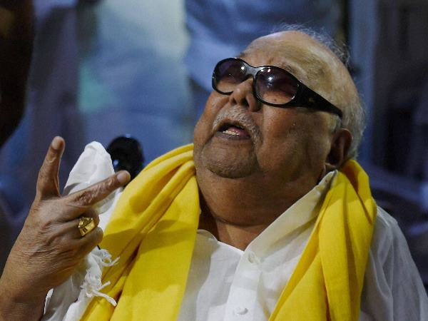 a masked man entered Karunanidhi's house and pointed gun at his wife