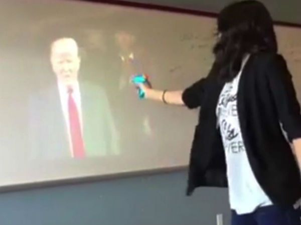 Teacher suspended over bizarre video of her 'shooting' President Trump and shouting 'die' in classroom