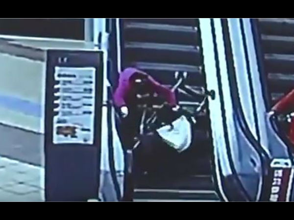 Video:Delivery guys save baby from injuring after stroller capsizes on escalator
