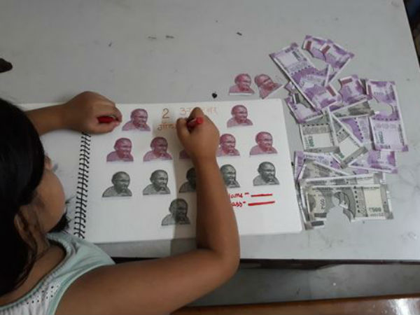 Picture of Girl Completing Gandhi Jayanti Project by Cutting Rs 500 & Rs 2000 Notes Goes Viral