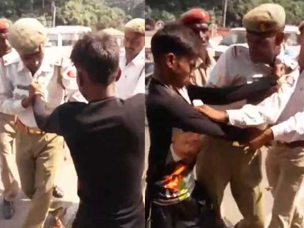 Traffic policeman has been beaten by youths in Saharanpur, Uttar Pradesh.