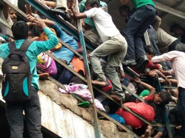 Mumbai Stampede: Railway probe report says due to heavy rain commuters werent moving out of footover bridge to avoid getting drenched