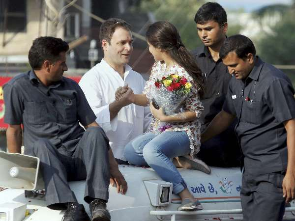VIDEO A girl gets onto Congress Vice President Rahul Gandhi vehicle in Bharuch Gujarat