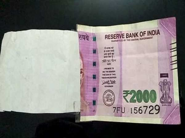 torn 2000 note withdraw in faridabad atm