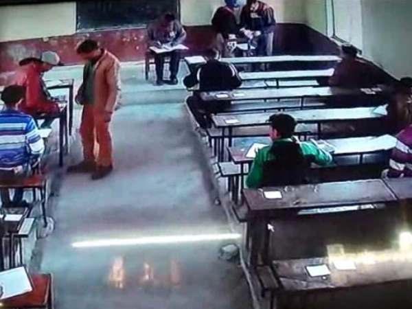 A student caught on CCTV cheating in UP Board classroom in Moradabad