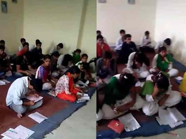 Examiner was walking in the examination room of revolver at Agra University