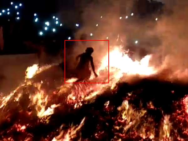 Panda of Mathura run through fire of Holika in Mathura
