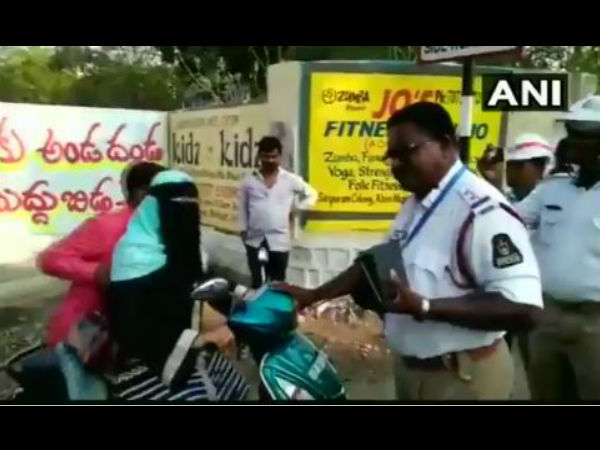 WATCH: A woman was seen fighting with police in Hyderabads Malakpet