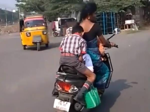 kiren rijiju share viral video boy doing homework on scooter mother driving