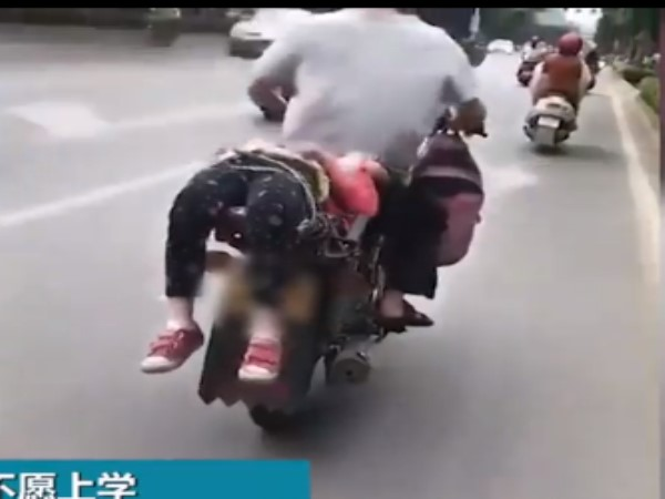 china father tied her daughter on bike and left to school