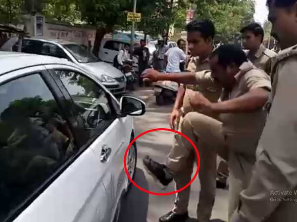 A policeman in Kanpur hitting a car after it accident