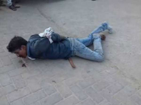A youth tied and in blood in front of hospital in Mainpuri