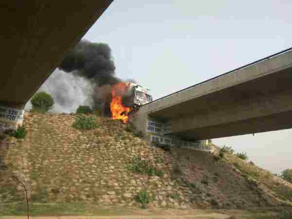 Photos of truck burning on highway in Allahabad