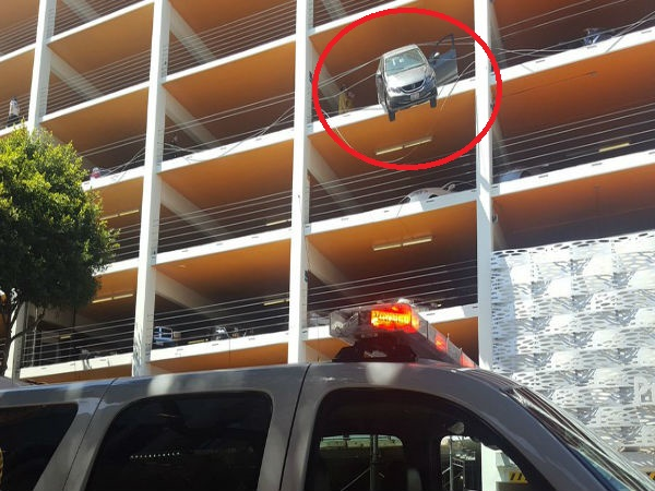 Driver accidentally hits accelerator, car hangs from the fourth floor of the multi-level parking