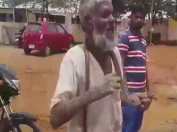 An old man went to office with cobra for getting pension in Karnataka