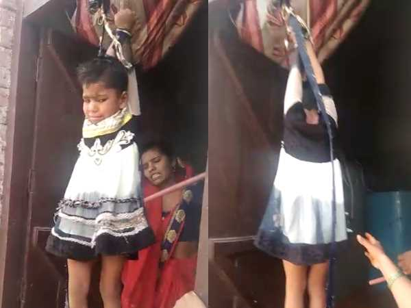 mother beat four year old daughter by hanging on the door in mathura