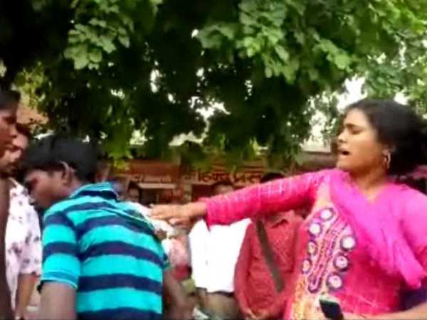 women beat boy teasing viral video beating on road in Mau