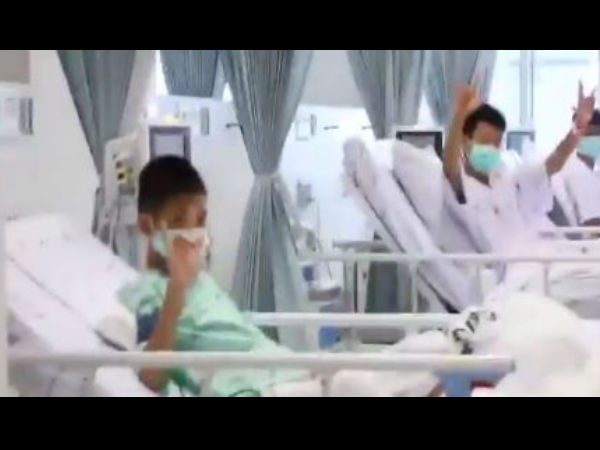 WATCH First video of the boys who were rescued from Tham Luang cave complex yesterday, wave & smile from their hospital beds