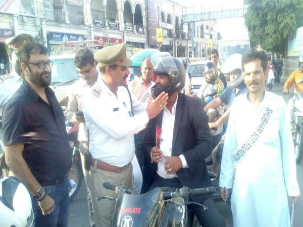 Lucknow traffic police gives red rose to a man for wearing helmet, leads to fight with wife.