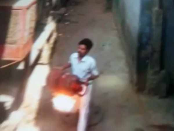 man chases women with a burning lpg cylinde video viral in allahabad