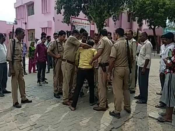 mainpuri man shoots another man in front of up police