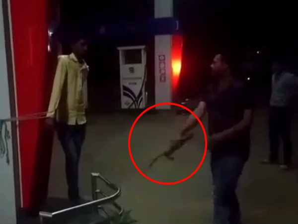 An employee at a in Hoshangabad being thrashed with whip for not coming to work