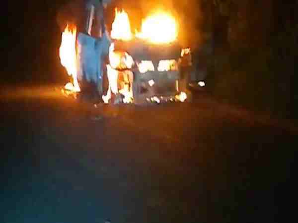 car catch fire on road