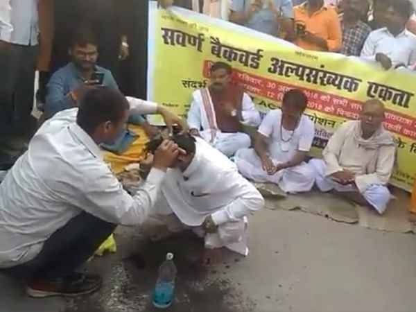 protest against sc st act, shaves off heads followed by last rites rituals in allahabad