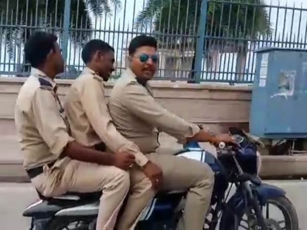 up police seeing riding bike tripling without helmet
