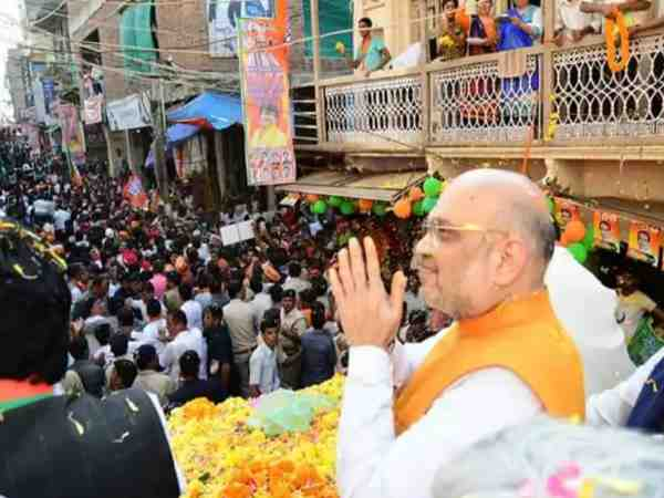 many people arrested in amit shah road show in guna rally
