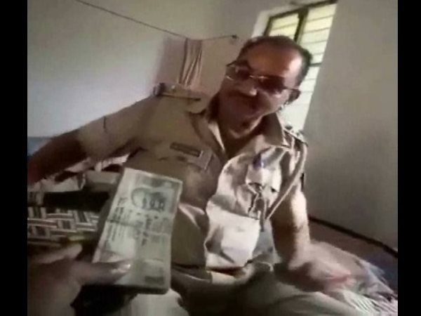 kanpur inspector caught on camera receiving bribe Sp suspended him