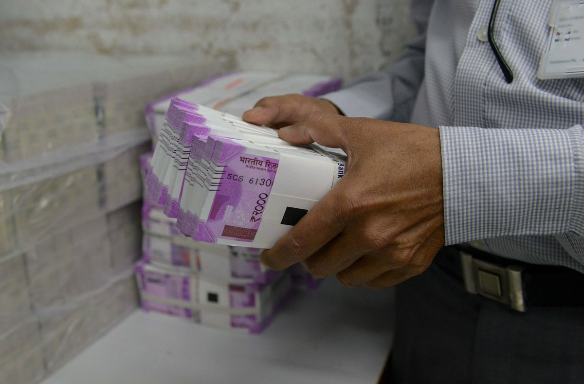 rupee gains against us dollar, reaches below 70 for the first time in three months
