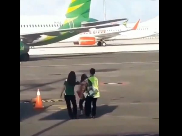 Woman Trying To Chase Plane After Missing Flight Video Viral