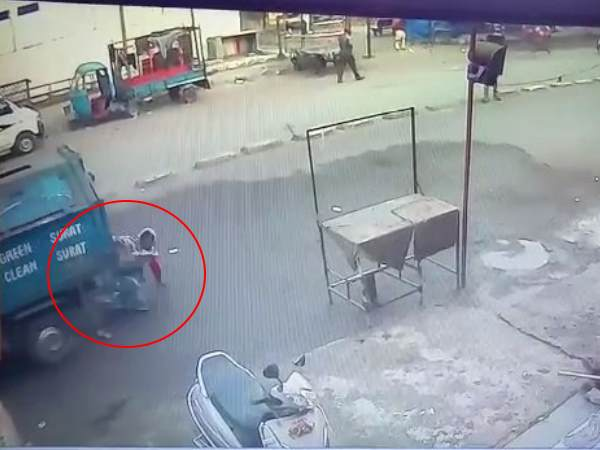 Vehicle passed over a woman in Surat and she saved see video