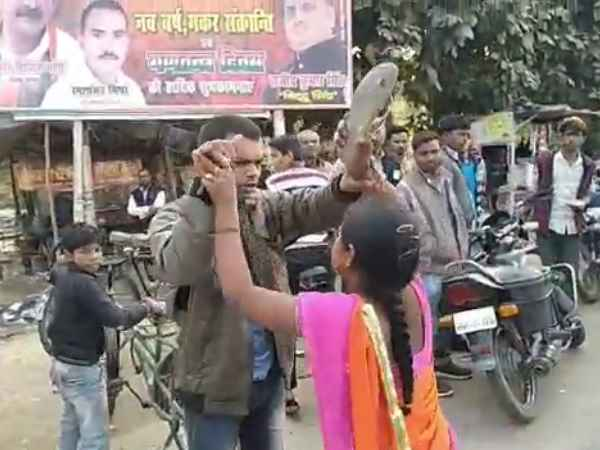 woman beat the young man in Gonda