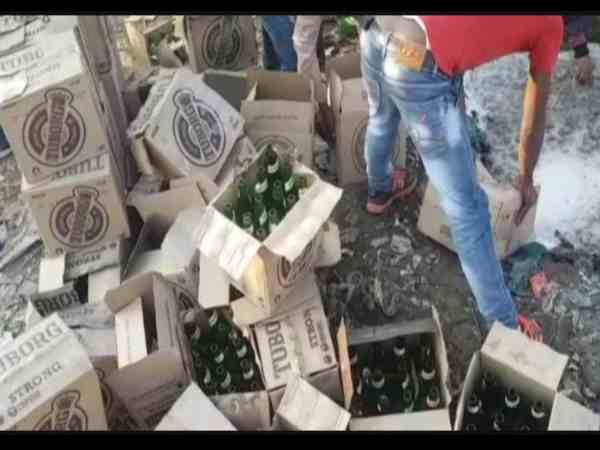police destroyed thousands of expired liquor bottles